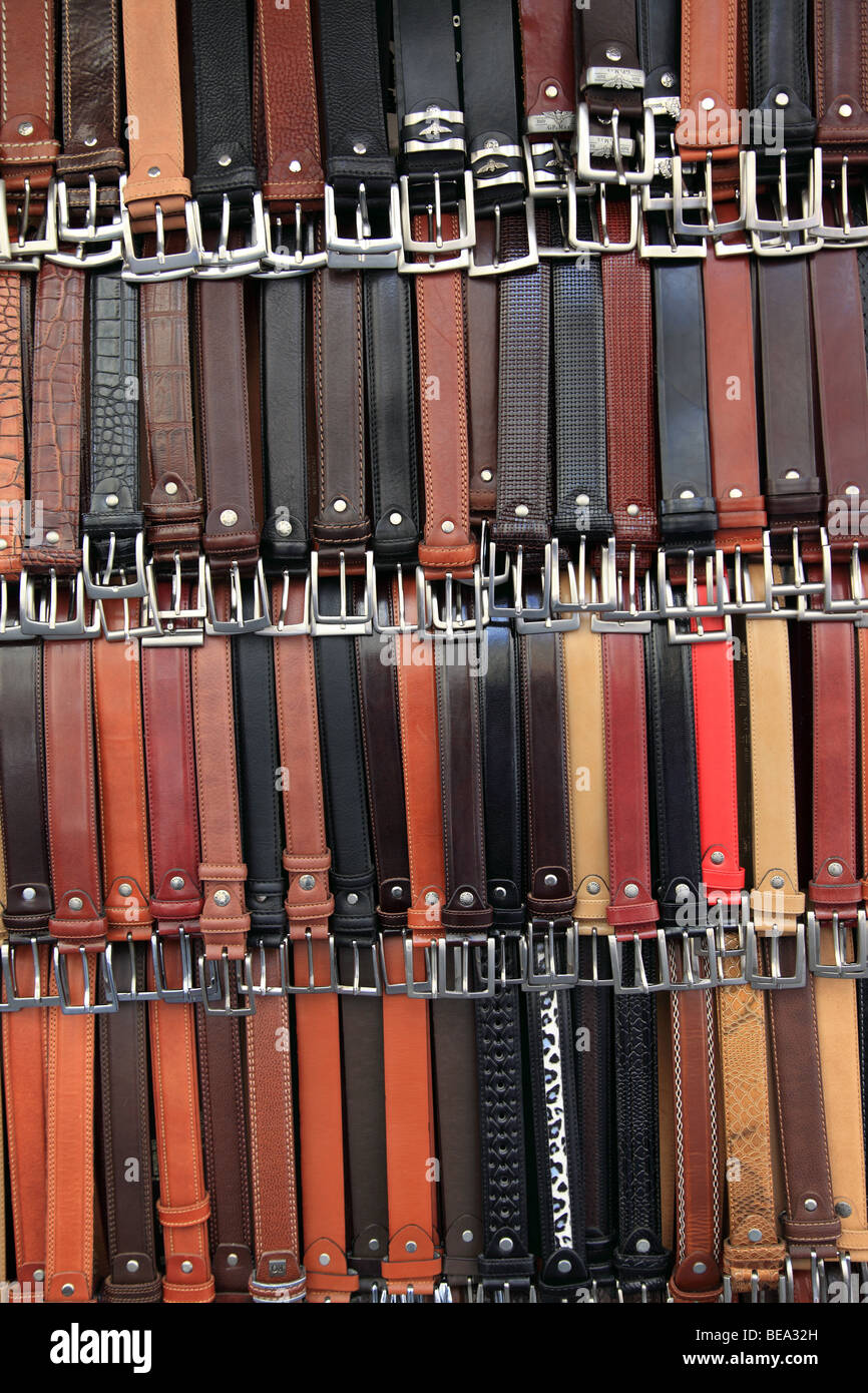 Leather belts displayed in Florence Italy - Stock Image