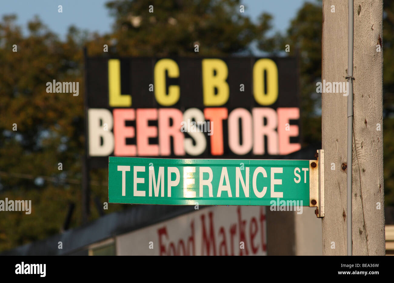 Conflicting Signs Indicating Temperance and Alcohol Consumption - Stock Image