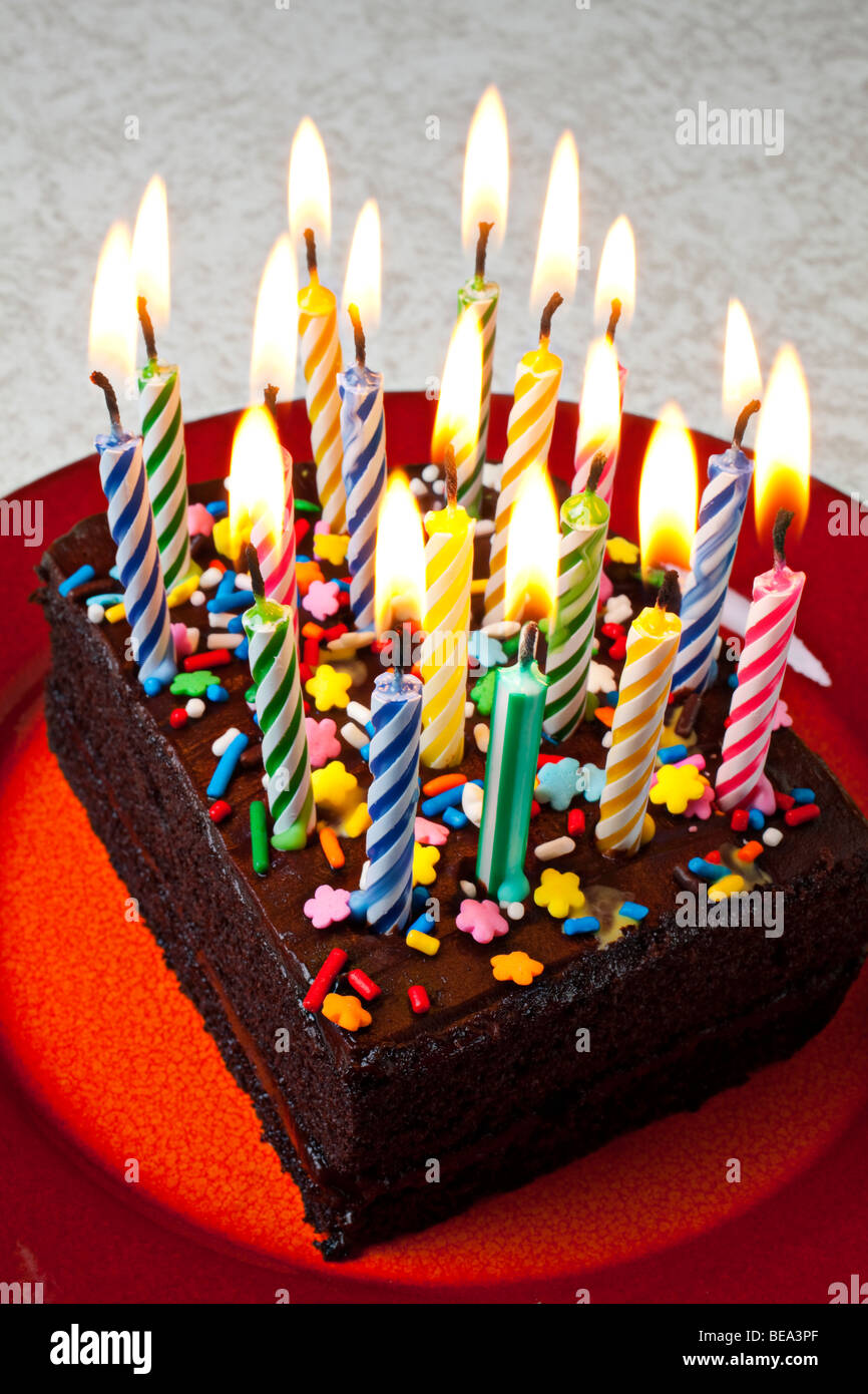 Chocolate Birthday Cake With Candles On Red Plate