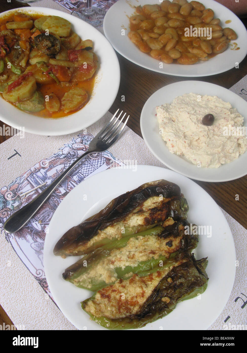 Greek Food. Stuffed Peppers, Briam, Giant Beans and Spicy Cheese dip. - Stock Image
