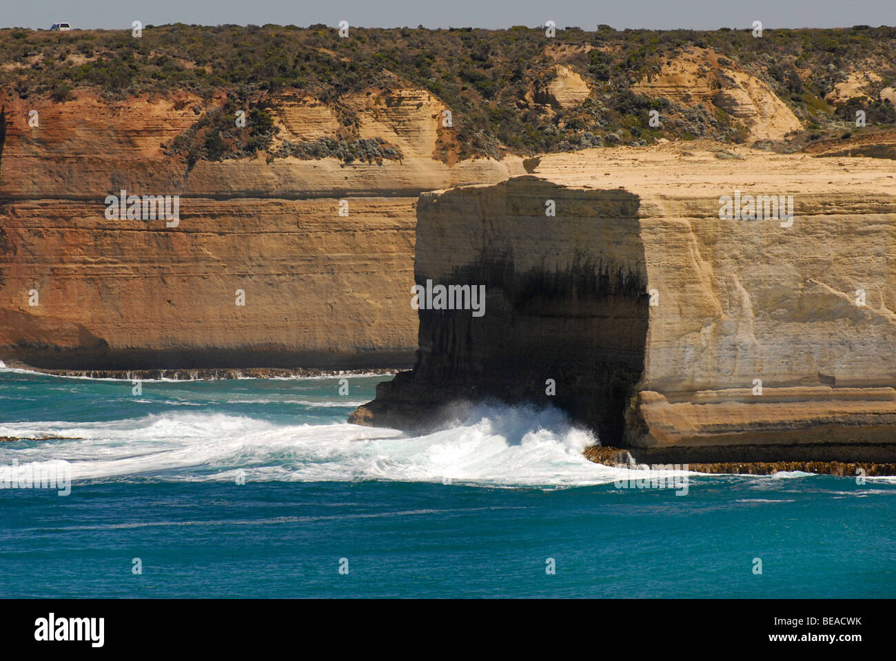 Water eroded coastline near the Twelve Apostles. Waves breaking. Ocean Road, Australia - Stock Image