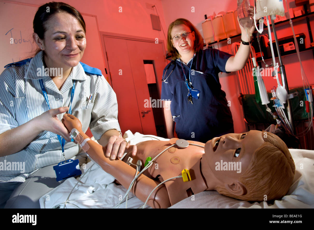 Nurse and staff nurse with a HPS, human interactive dummy at Bristol Medical Simulation Center. UK - Stock Image