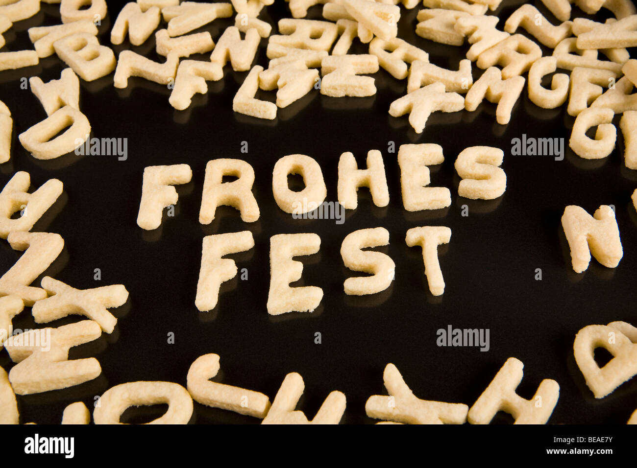Letter cookies spelling out the German phrase Frohes Fest - Stock Image