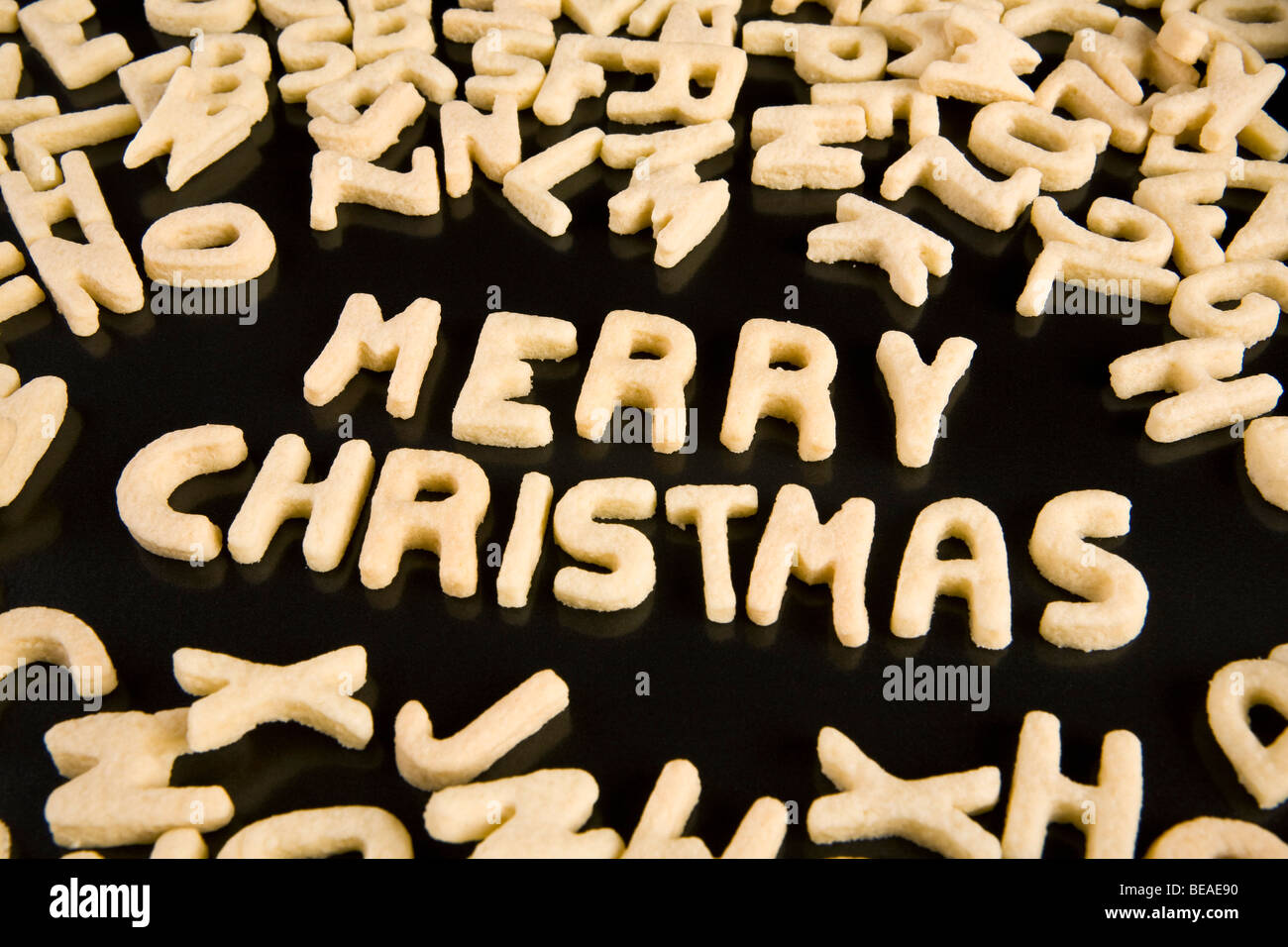 Letter cookies spelling out the phrase Merry Christmas - Stock Image