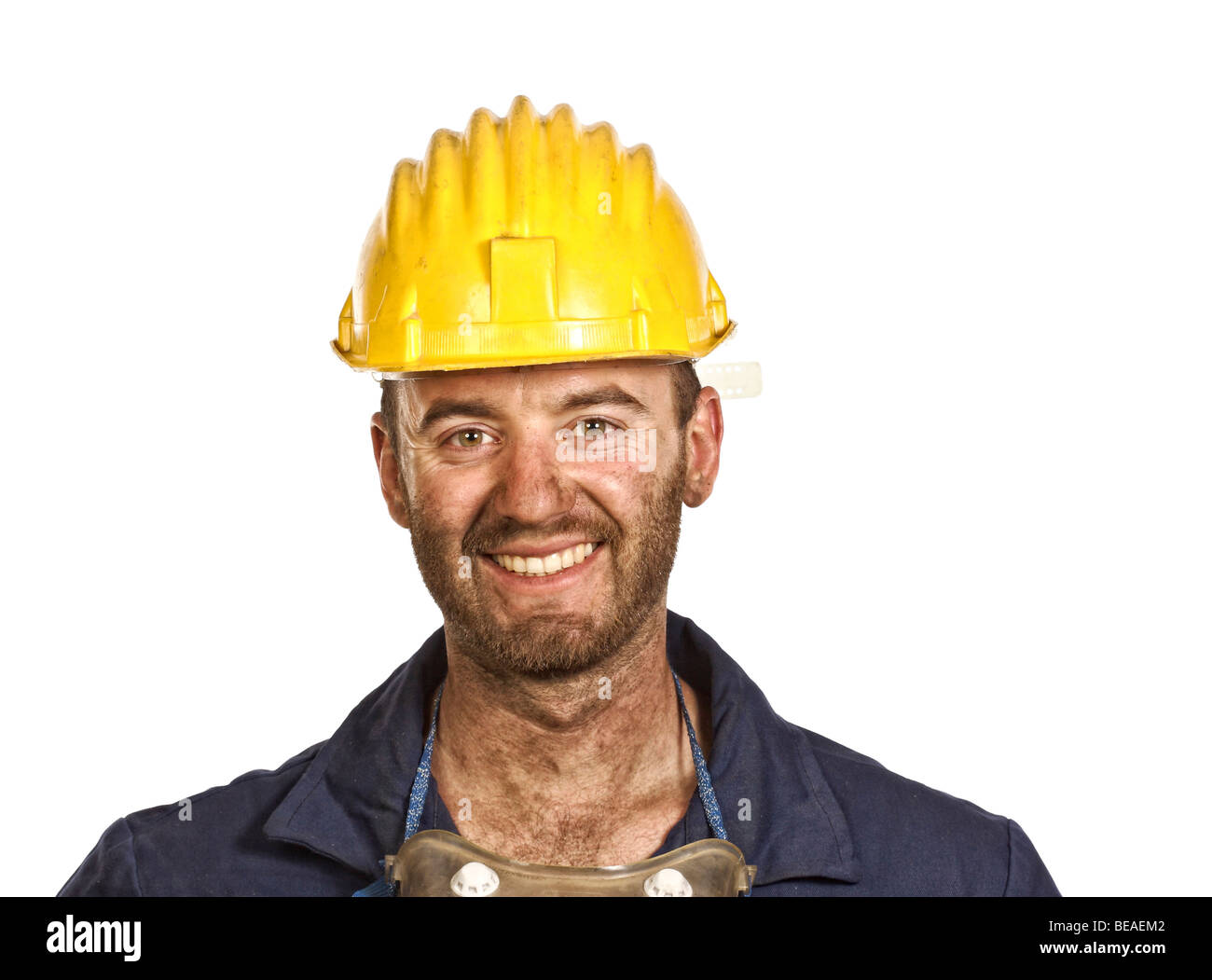 smiling young caucasian labourer heavy industry manual worker - Stock Image