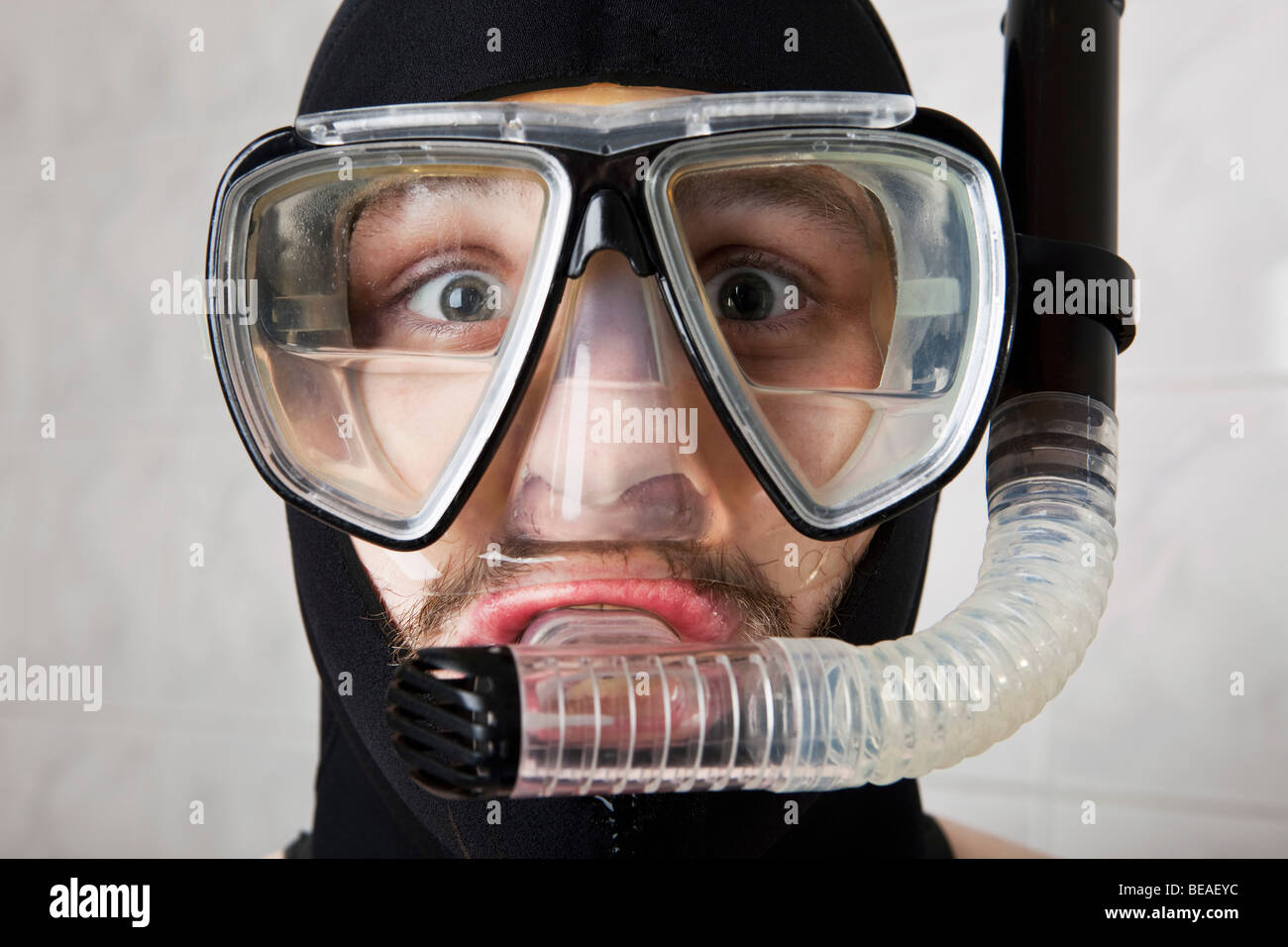 A wearing a scuba mask half full of water - Stock Image