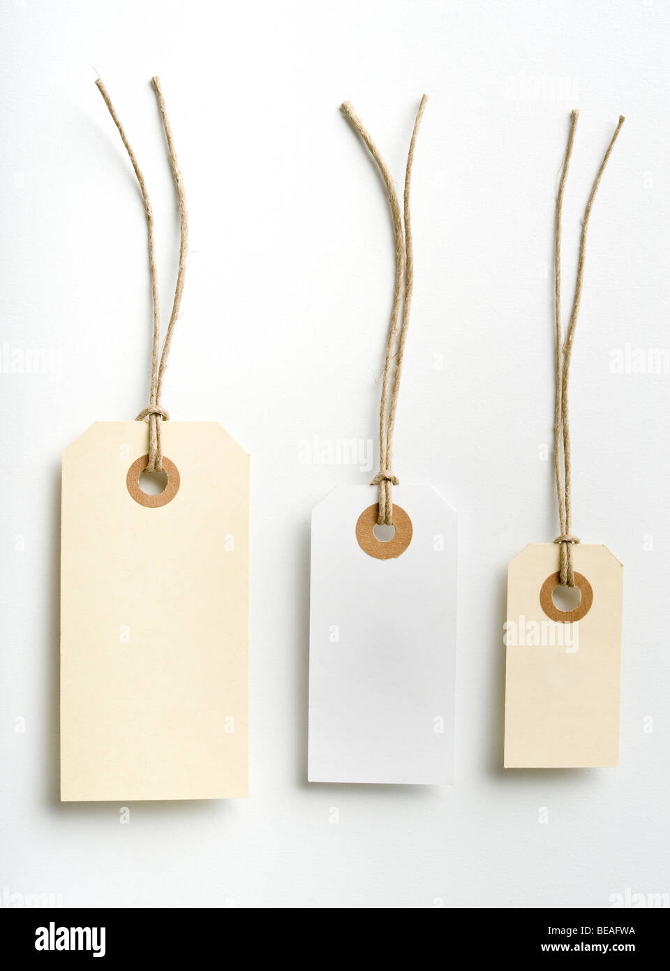 Three labels with simple rope isolated on white - Stock Image