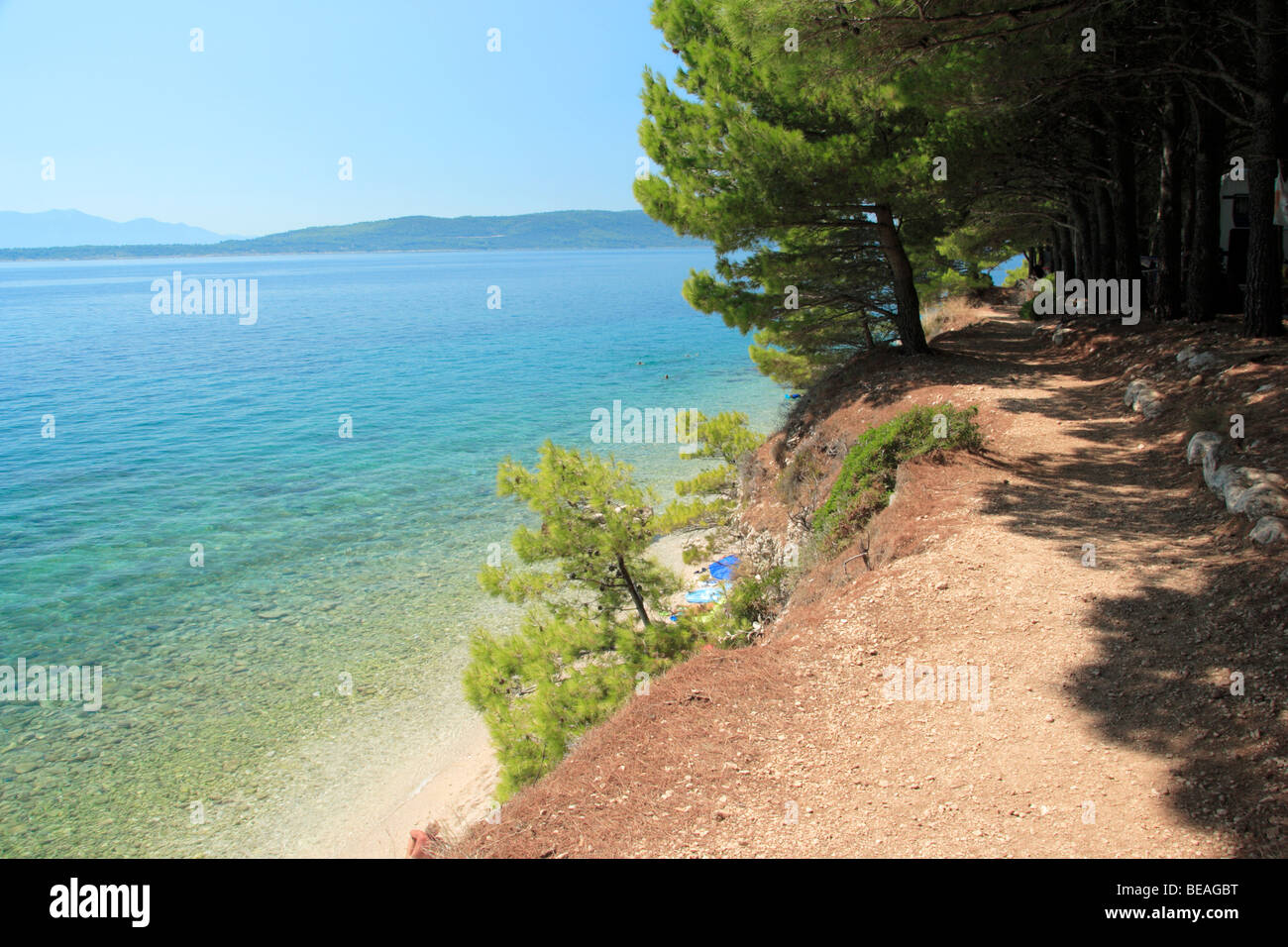 Narrow path,on the top of the cliff, leading along Dole Campsite in Zivogosce, Croatia - Stock Image