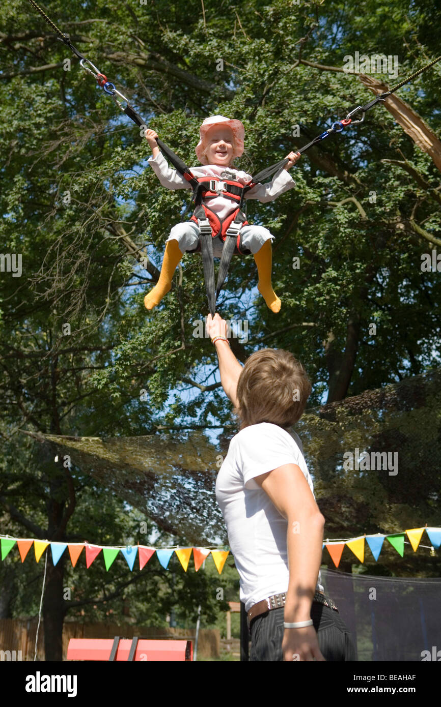 Little girl on bungee jumping. Stock Photo