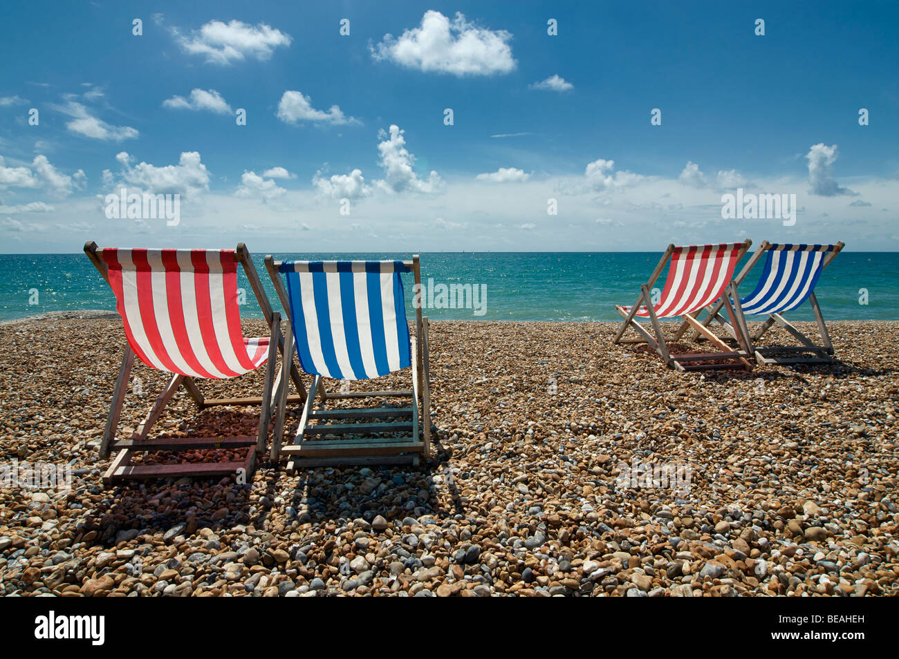 Empty deckchairs on Brighton beach, England - Stock Image