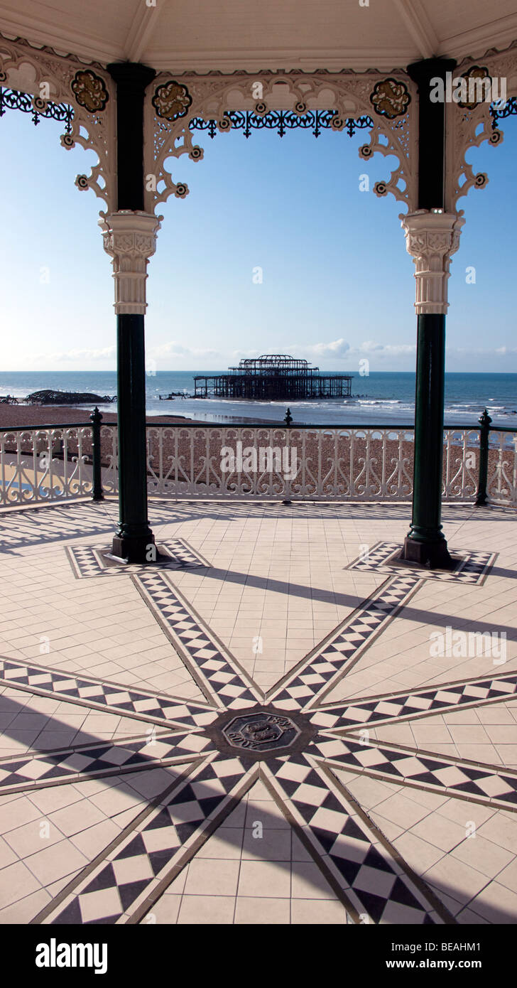 The restored Victorian bandstand overlooking Brighton beach and the remains of the West Pier. Brighton, England - Stock Image