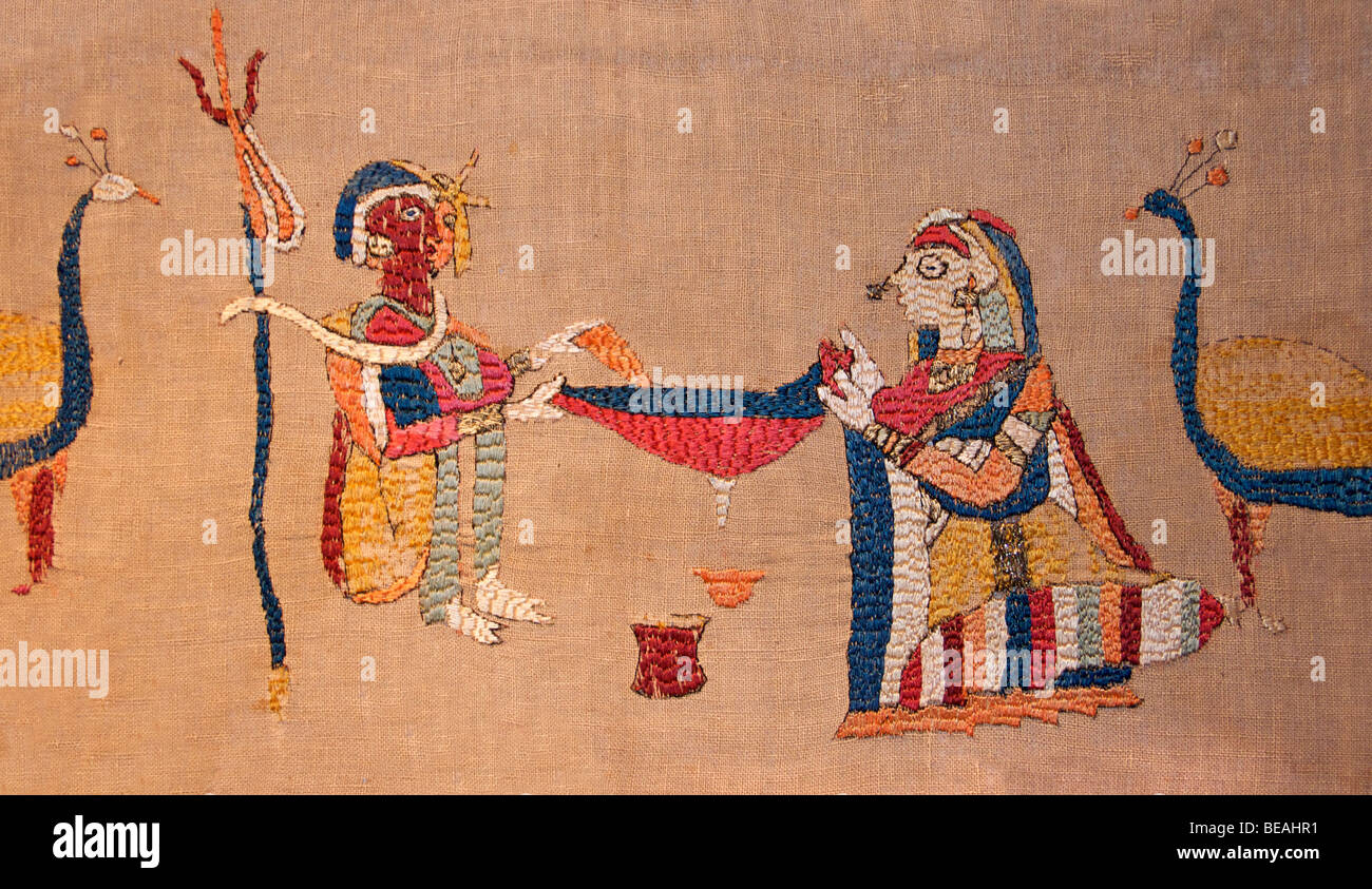 Detail of an embroidered rumal depicting Shiva and Parvati filtering bhang. Indian textile - Stock Image