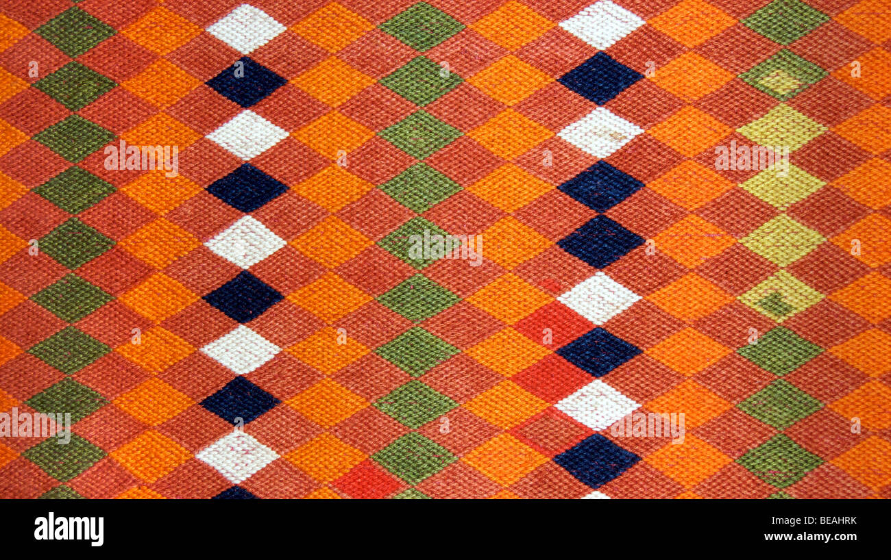 Detail of an embroidered Banjara cotton belt with geometric patterning. From South central India - Stock Image