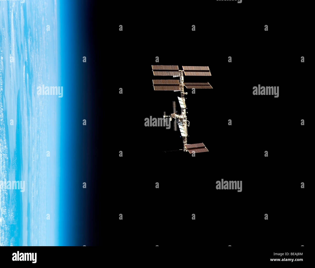 The ISS International Space Station with earth and atmoshere beyond. Optimised version of an original NASA image. - Stock Image