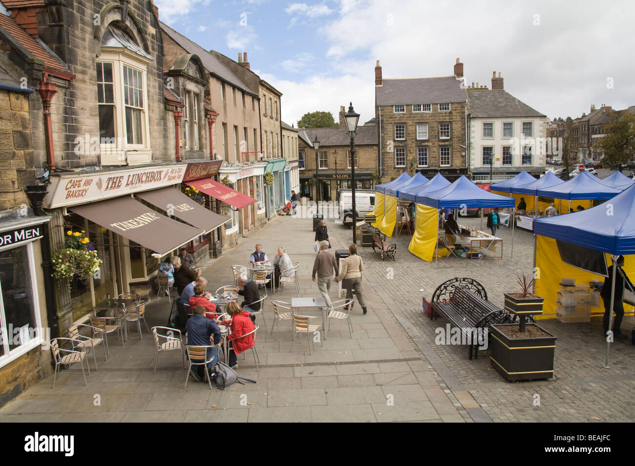 Alnwick Northumberland England UK Looking down on the stalls of weekly market in Market Place - Stock Image