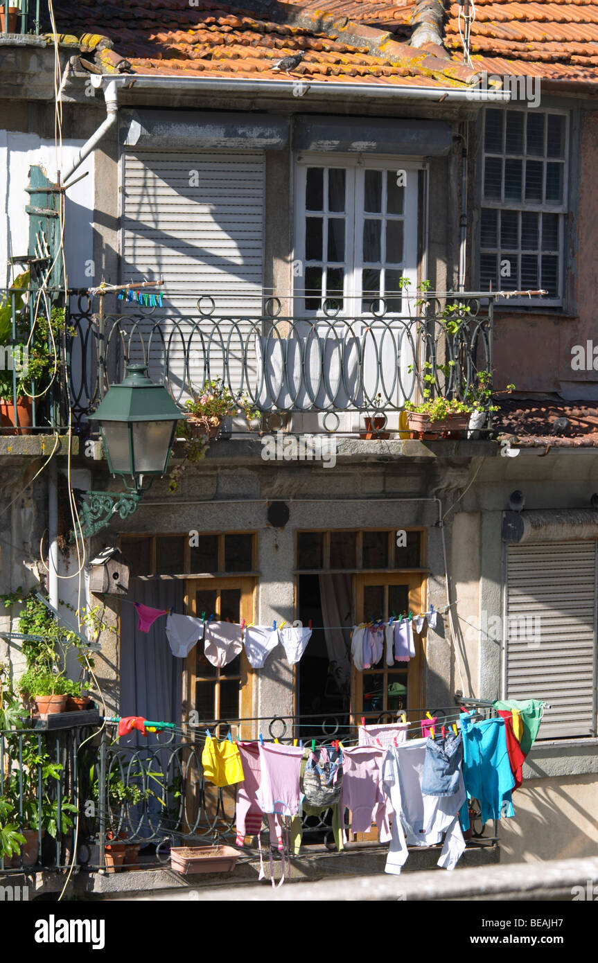 apartment buildings facade with laundry porto portugal - Stock Image