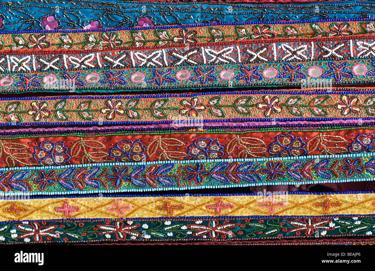 Beadwork decoarted textile ribbons on a market stall selling ethnic souvenirs, Katmandhu, Nepal - Stock Image