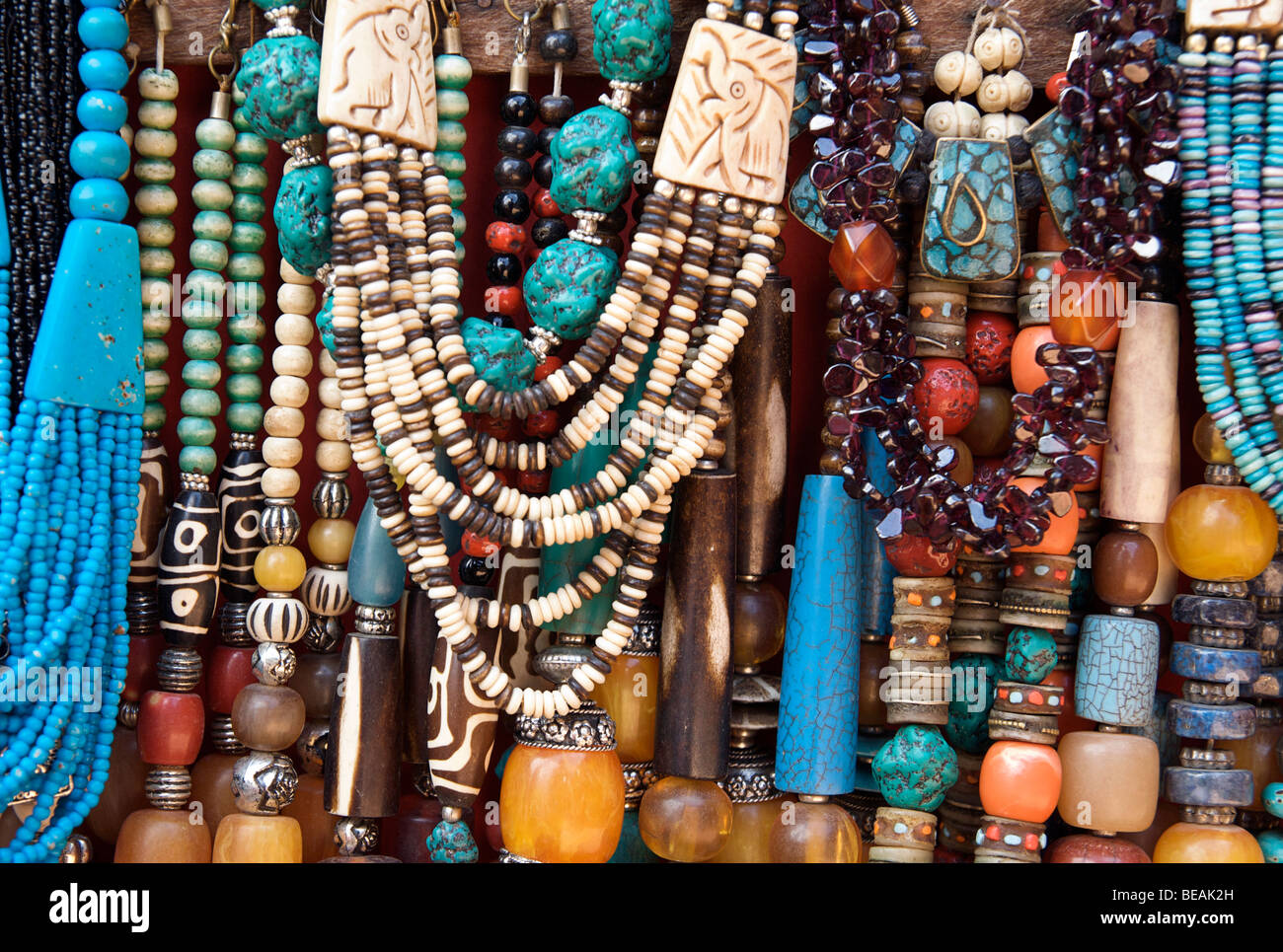 Detail of bead necklaces for sale on a stall of souvenirs. Nepal - Stock Image