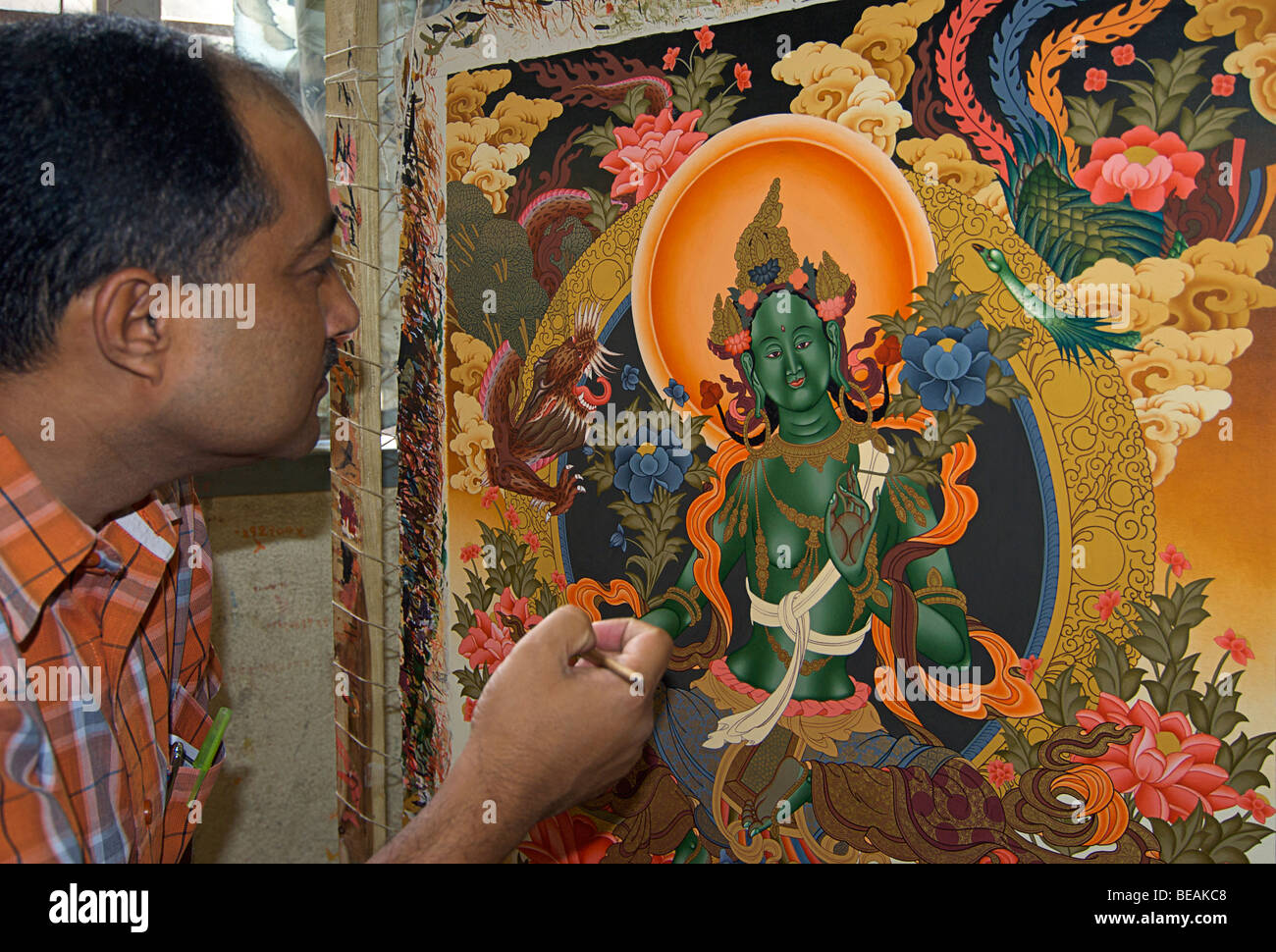 Nepalese man with brush to an intricate painting.  Katmandhu, Nepal. SUBJECT IS MODEL RELEASED - Stock Image