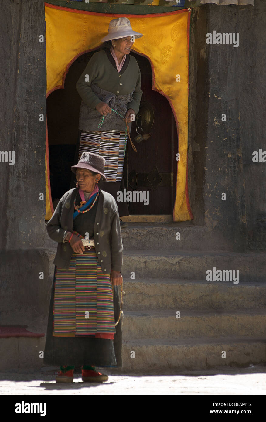 Tibetan women at Sakya monastery, Tibet - Stock Image