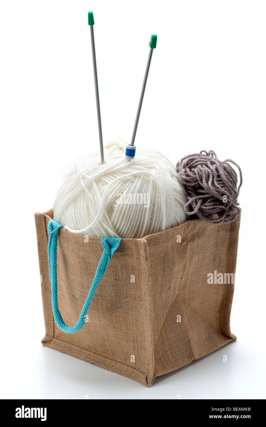 White ball of wool in a hessian bag - Stock Image