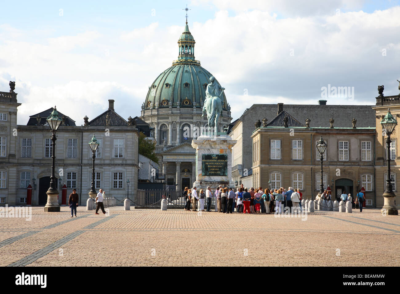 View towards the Marble Church in Copenhagen through the palace yard of Amalienborg Palace with the equestrian statue. - Stock Image
