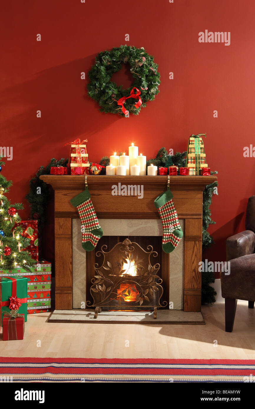 Fireplace decorated for Christmas - Stock Image