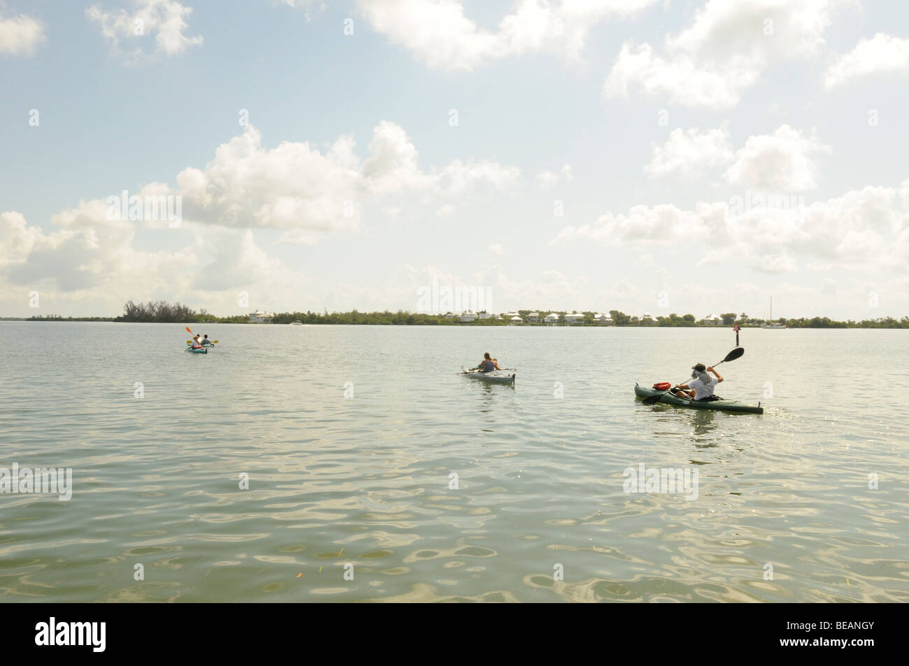 Kayakers paddle across the inter coastal waterway towards Useppa Island, Florida. - Stock Image