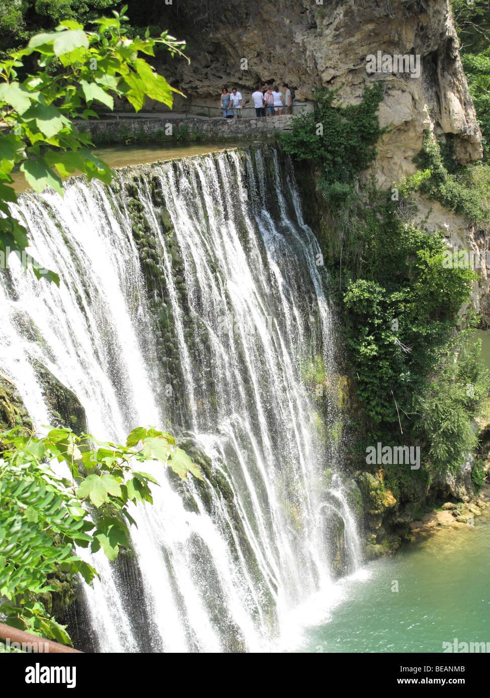 Tourist on sightseeing Pliva waterfalls in town of Jajce, Bosnia and Herzegovina Stock Photo