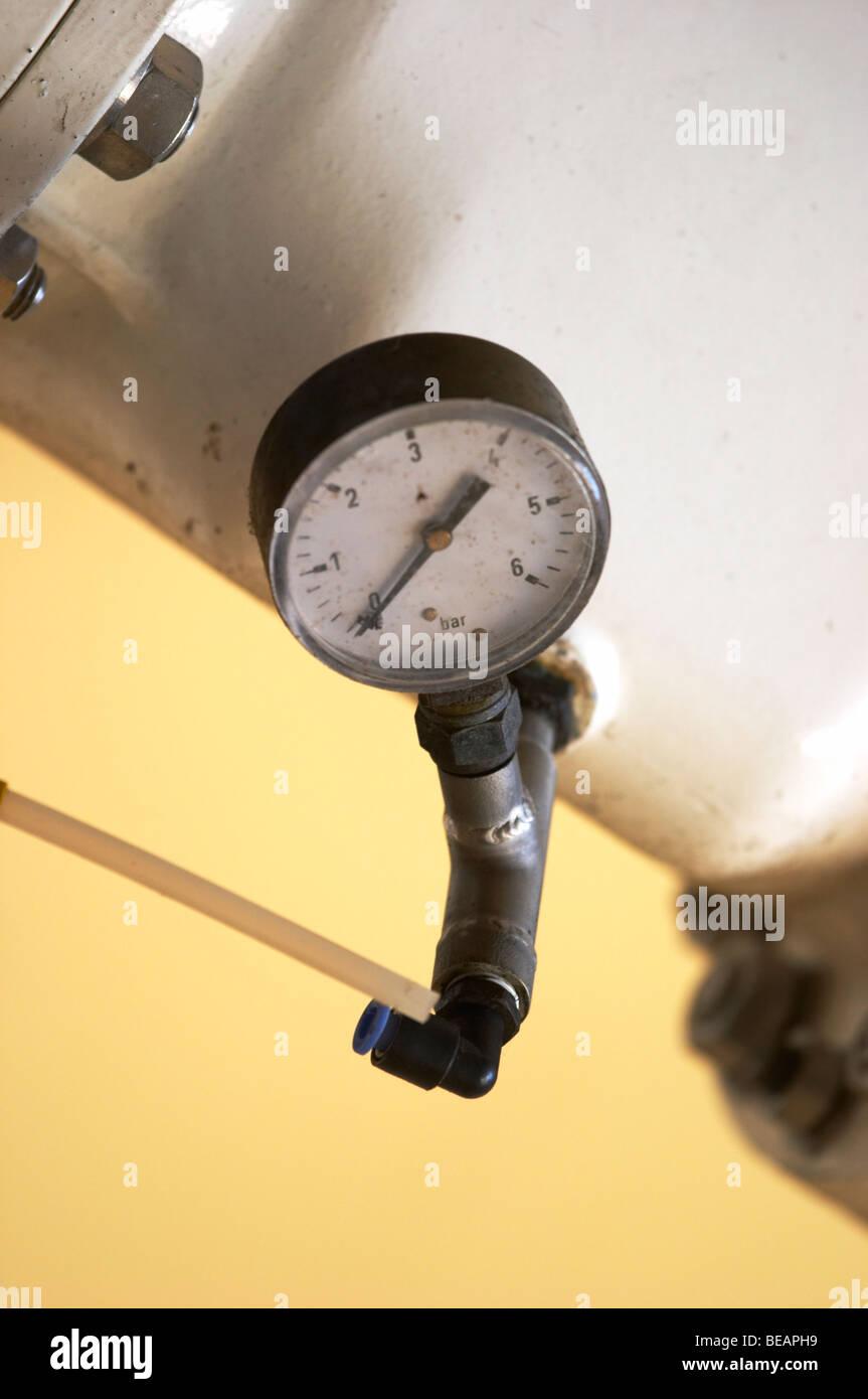 valve and pressure gauge on must pumping tube chateau phelan segur st estephe medoc bordeaux france - Stock Image