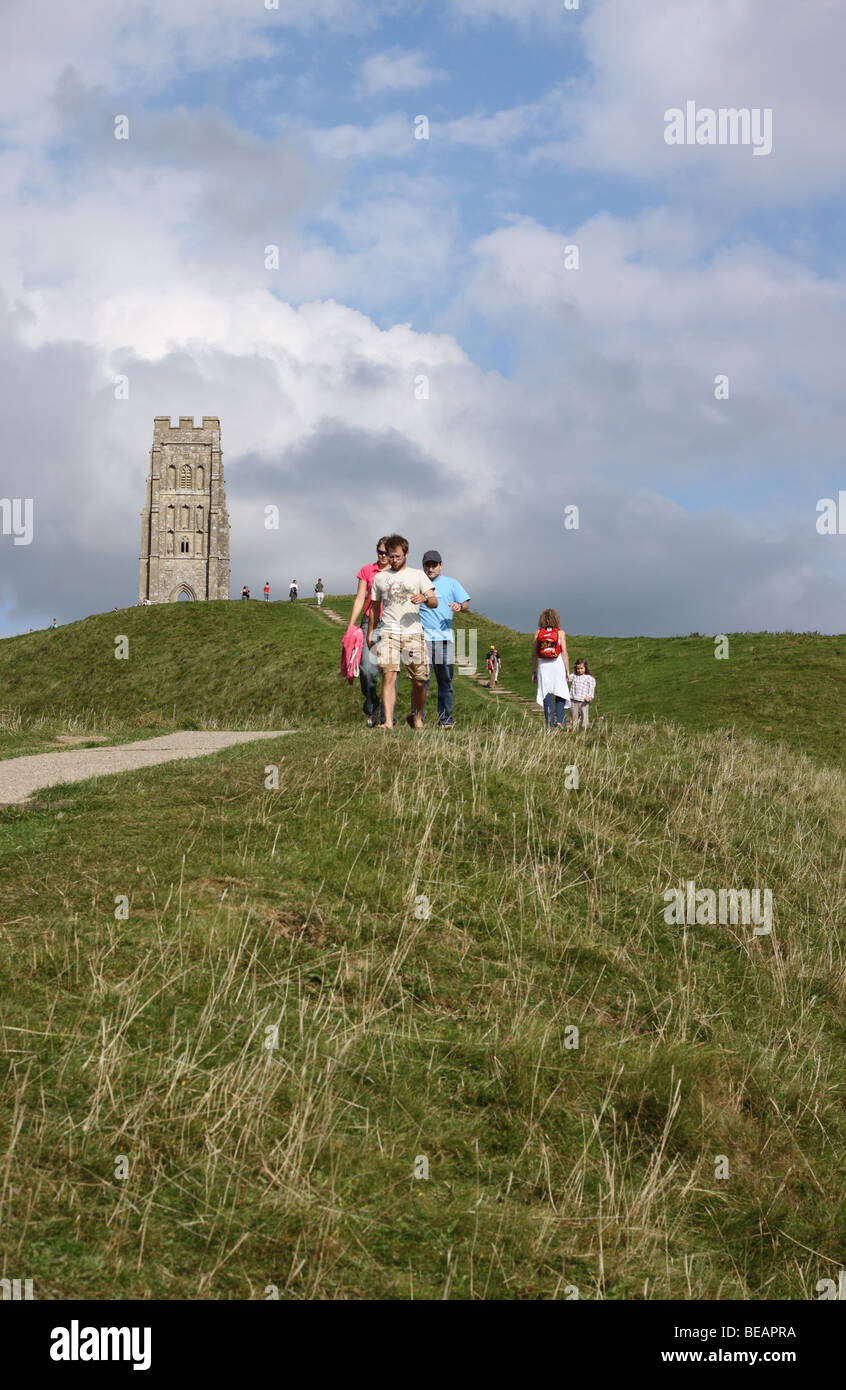 Glastonbury Tor Somerset visitors tourists on the footpath to the tower in September - Stock Image