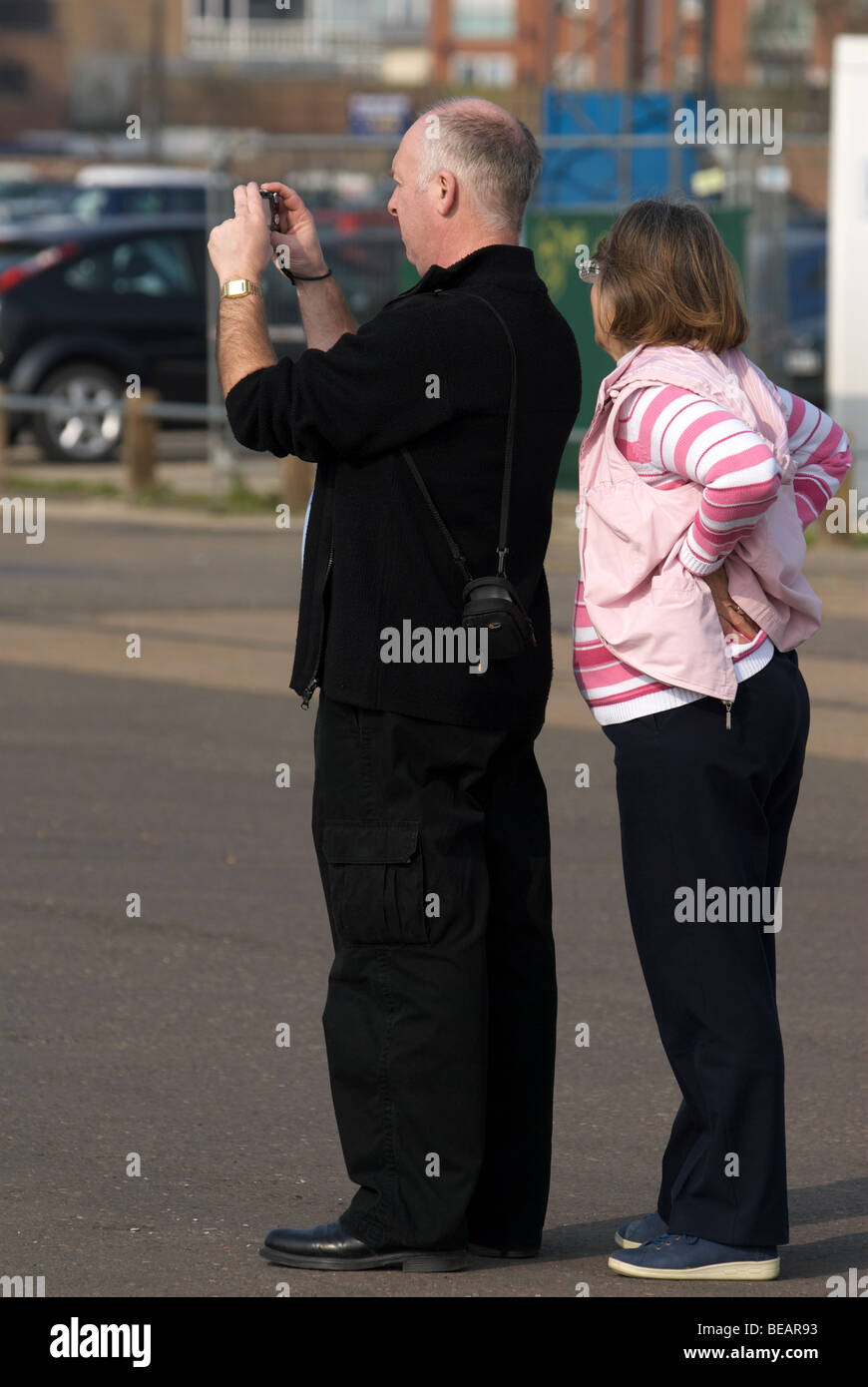 Sightseers photographing the new developments on Ipswich waterfront, Suffolk, UK. - Stock Image