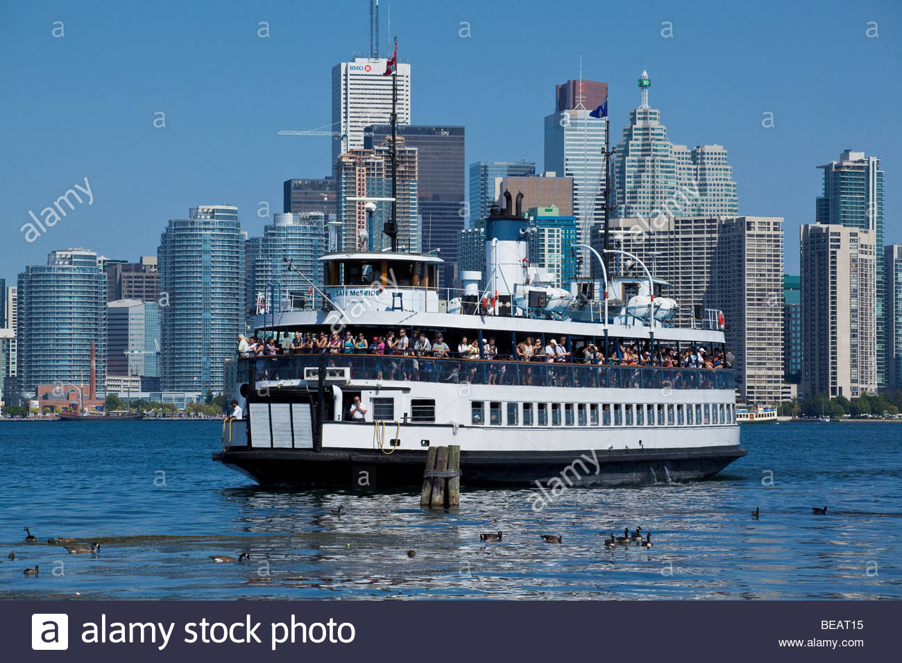 Ferry on way to Toronto Islands Park with city in background at Toronto Ontario Canada Stock Photo