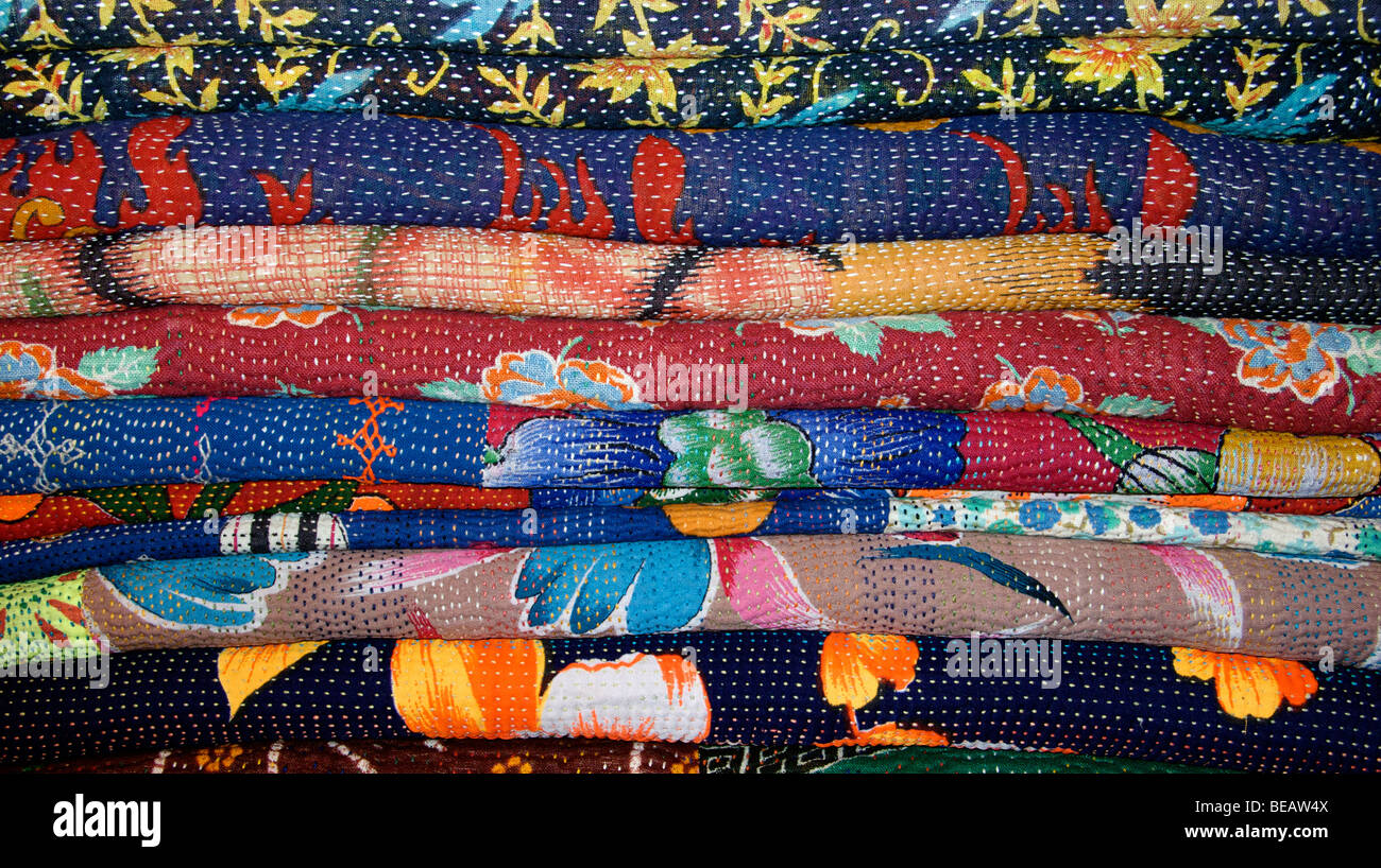 Stack of quilted and patched mats from Sind province, Pakistan - Stock Image
