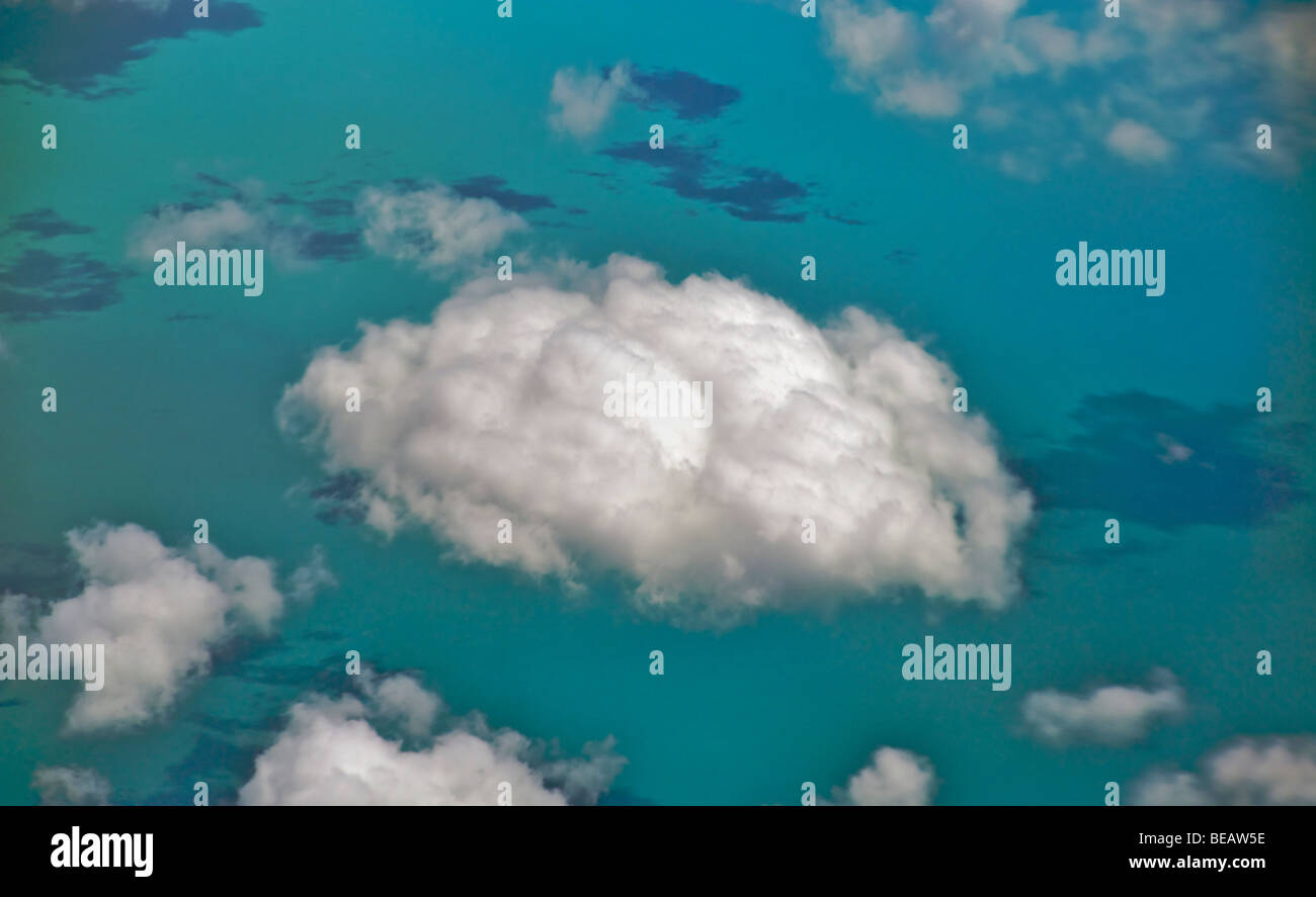 Fluffy clouds above the caribbean sea - Stock Image