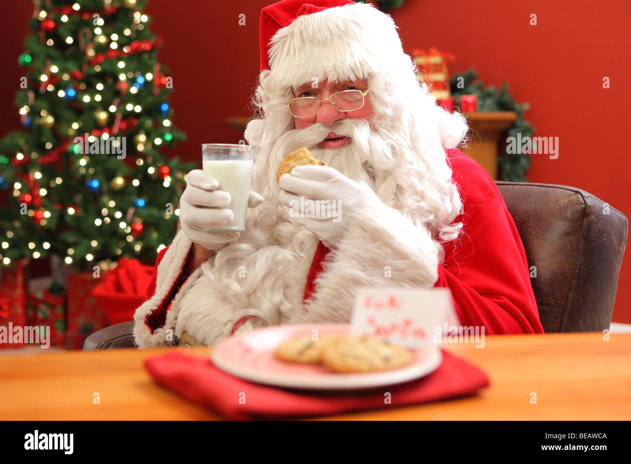 Santa Claus Eating Cookies With Glass Of Milk Stock Photo 26055018