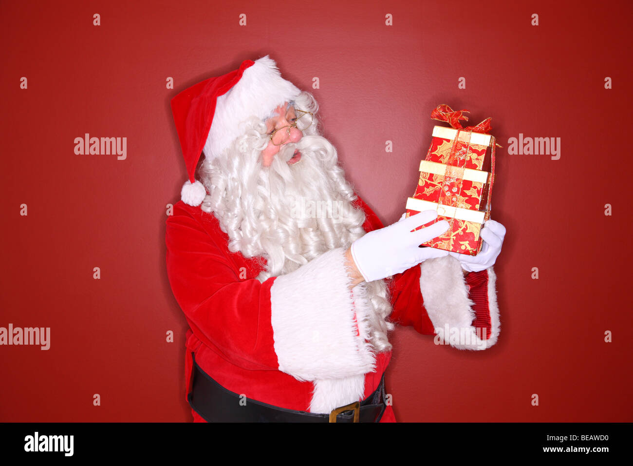 Santa holding present - Stock Image