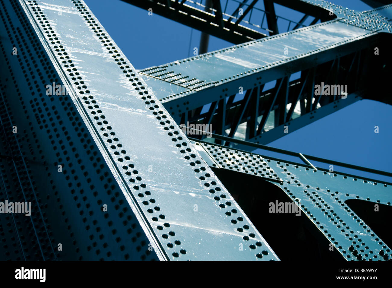 riveted bridge support in green - Stock Image