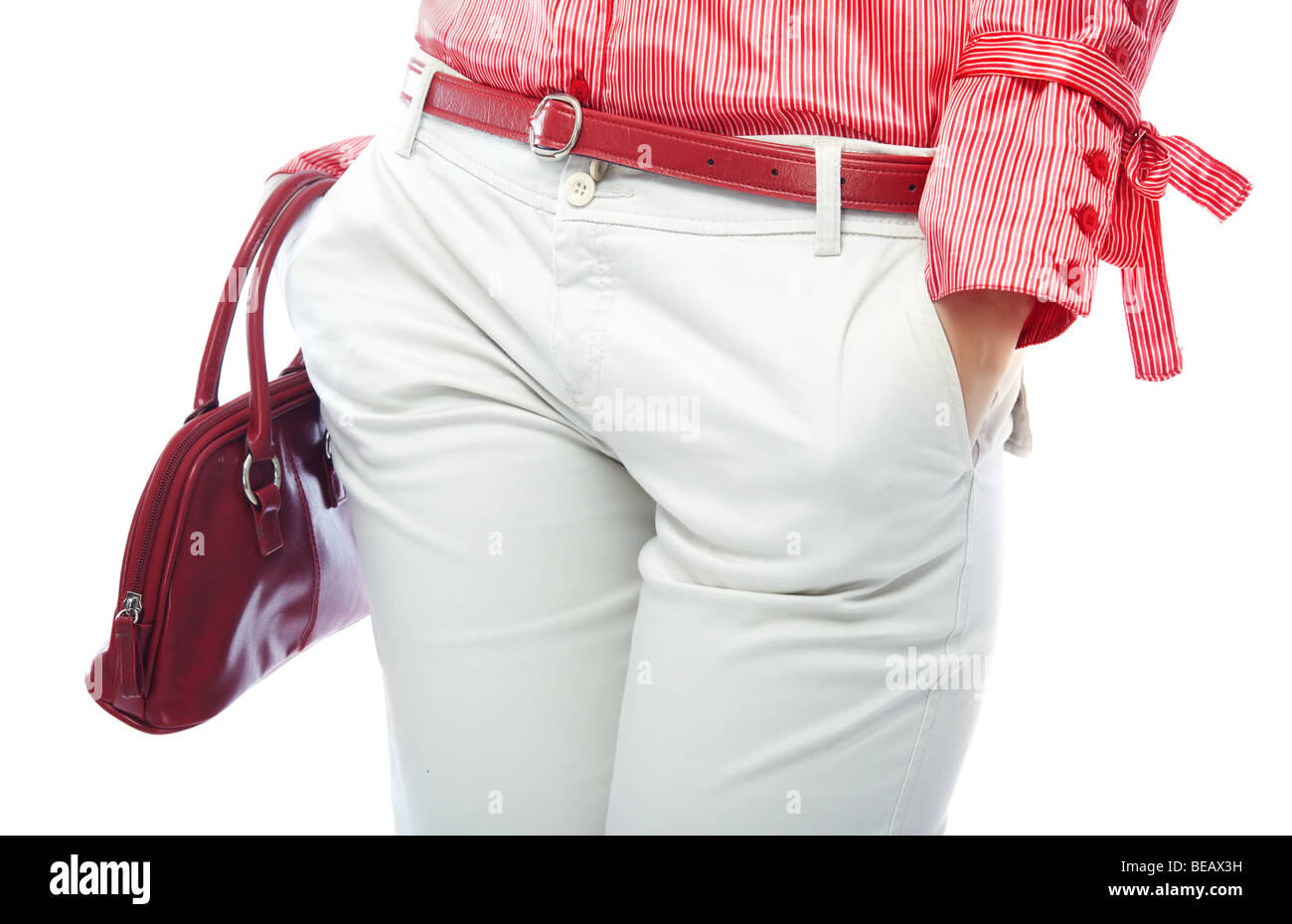 Body part of stylish lady in modern clothes with fashionable bag - Stock Image