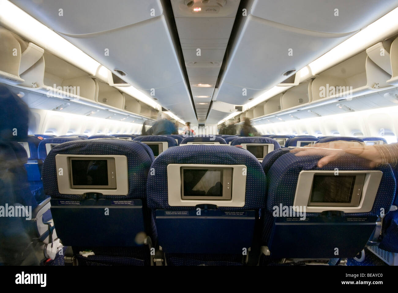 plane interior of the economy class in an el al boeing 767 airplane