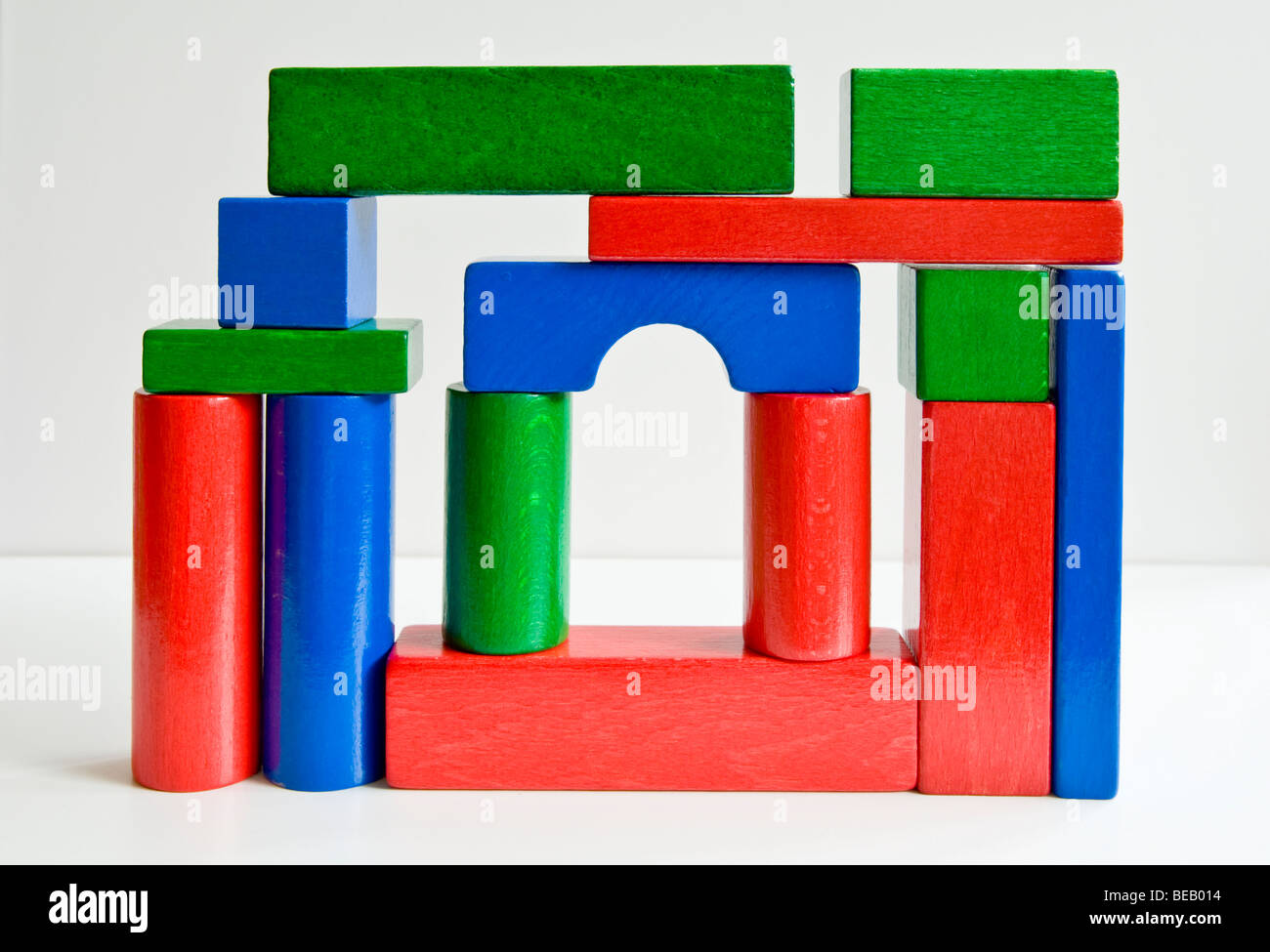 A collection of colourful building bricks arranged as a random structure. - Stock Image
