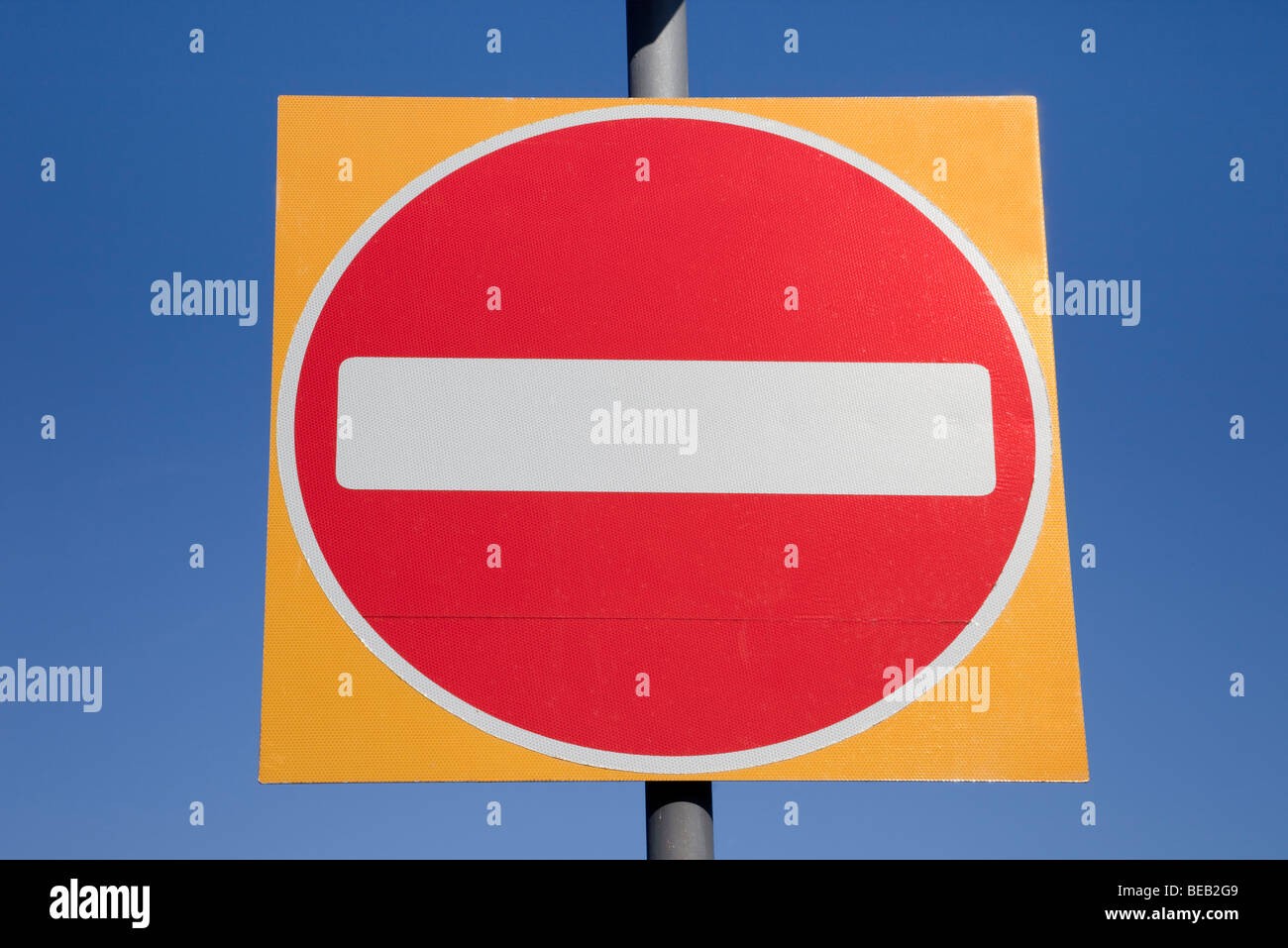 No entry road sign isolated on a blue sky. England, UK, Britain - Stock Image