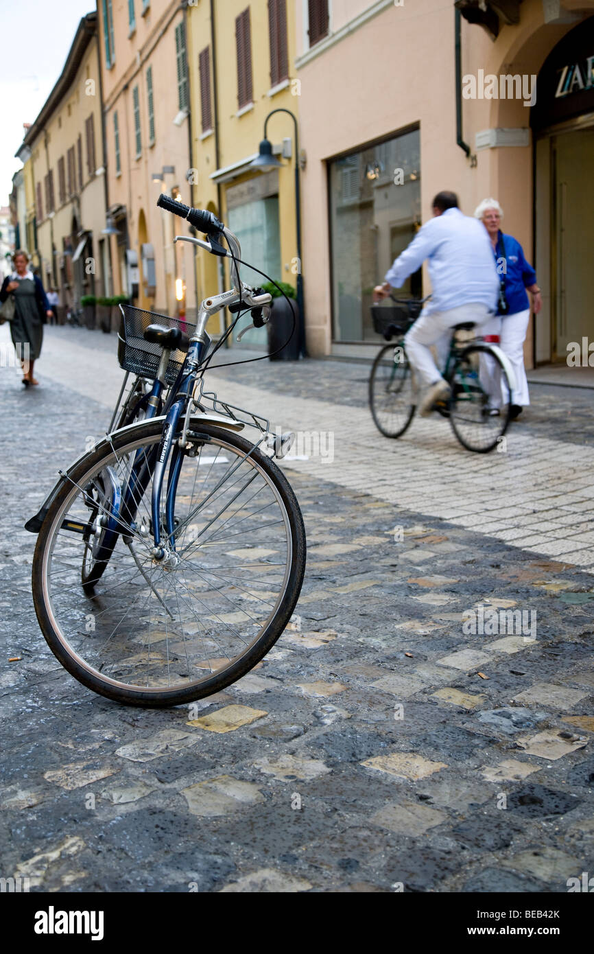 Bicycle on it's stand on block paved street. - Stock Image