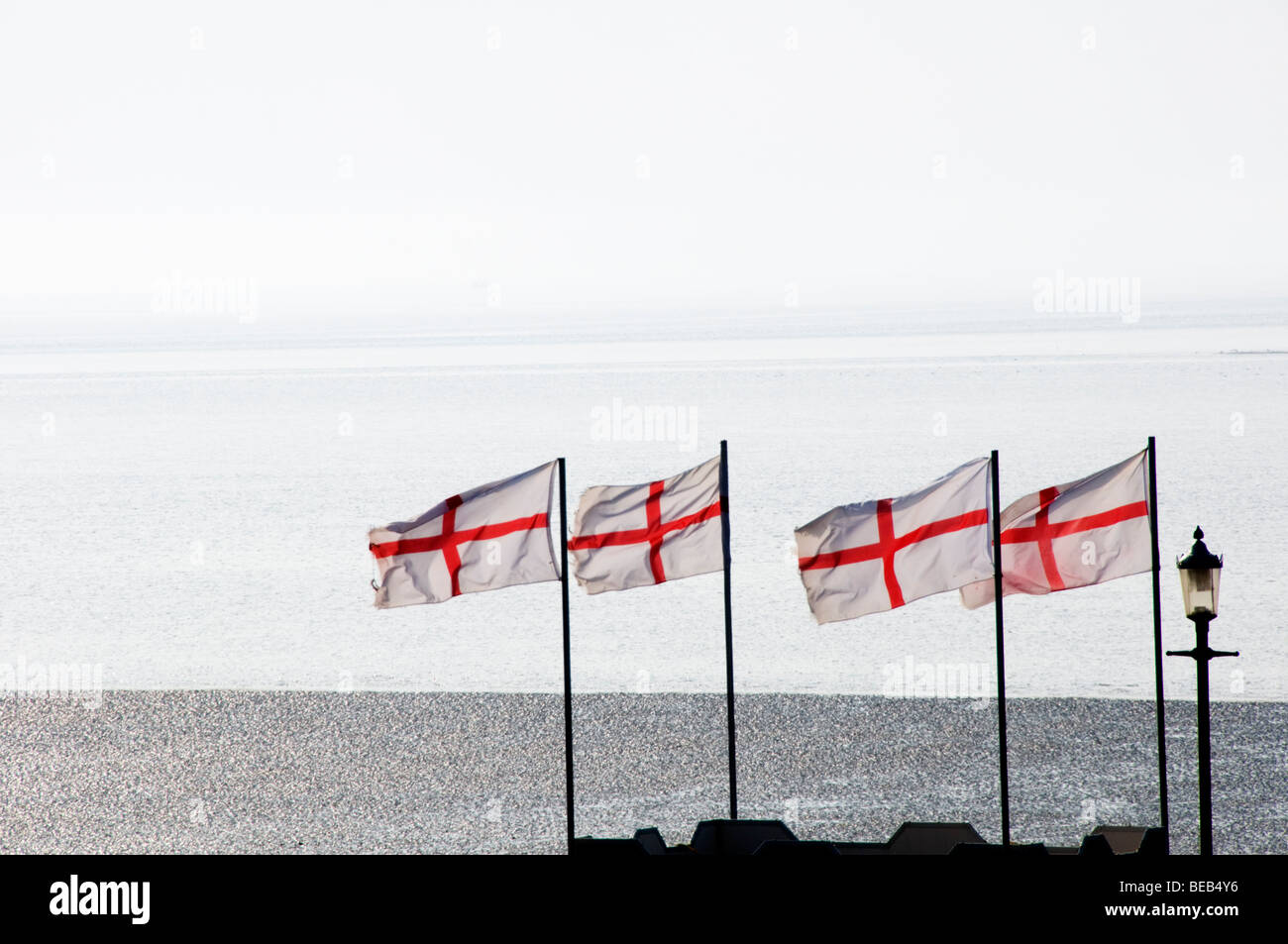 Flags of St George flying at the English coast Stock Photo