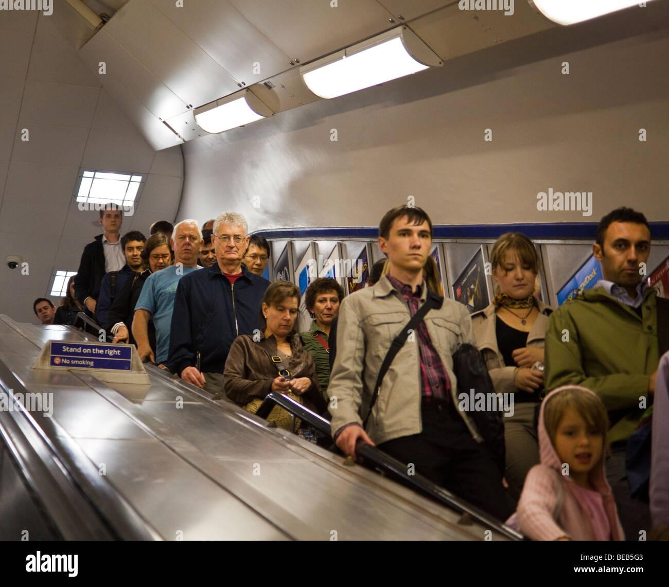 commuters on escalator, London Underground, London, England, UK - Stock Image
