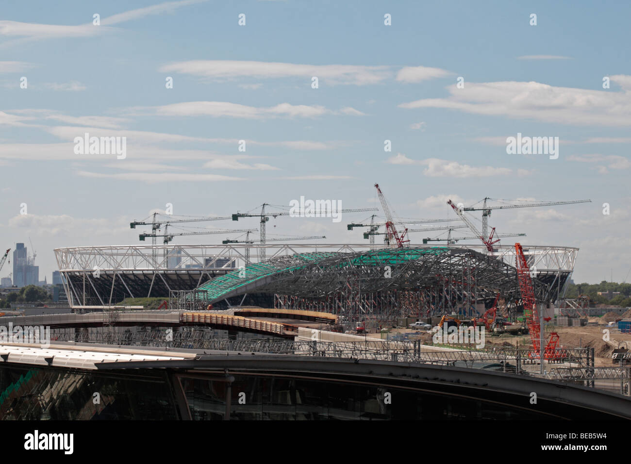 View from close to Stratford Station towards the Athletics and Aquatics stadiums at the London 2012 Olympic site - Stock Image