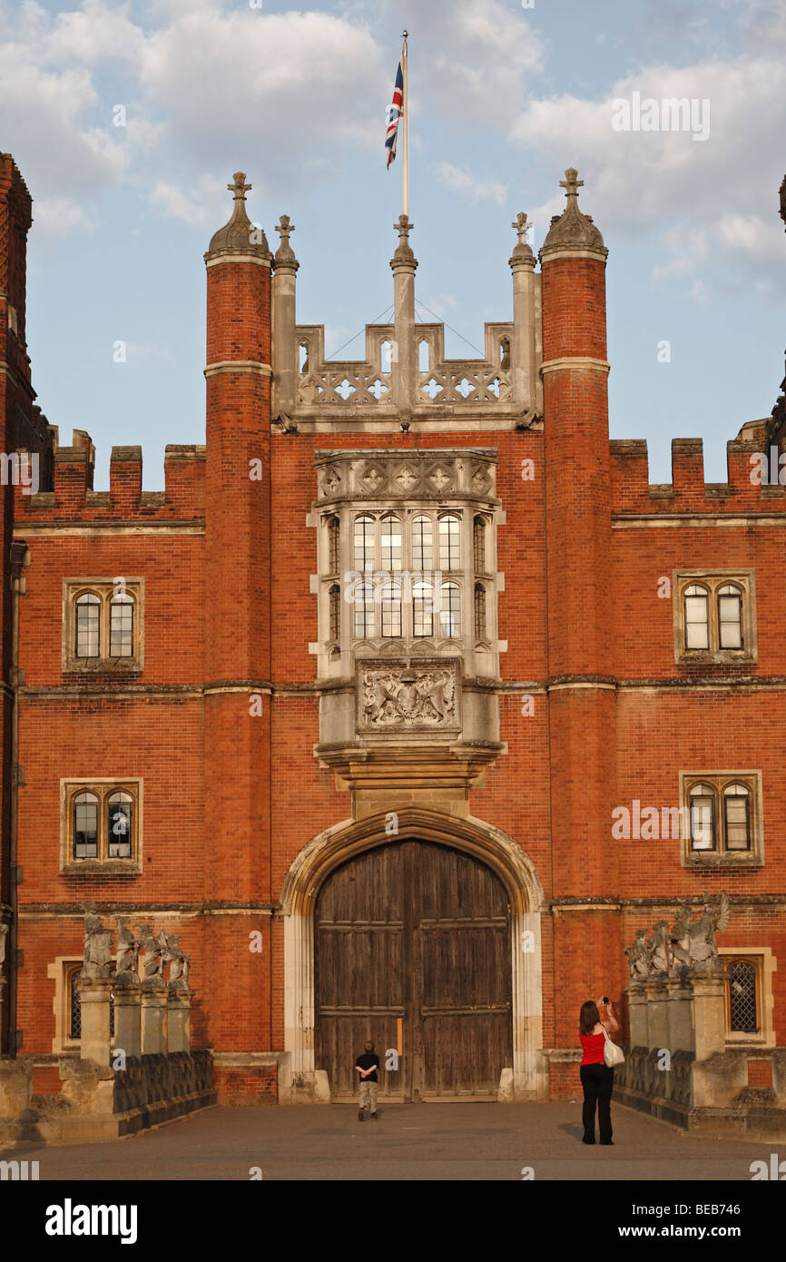 A young boy and his mother at sun baked main entrance to Hampton Court Palace, Surrey, UK on a lovely summer's - Stock Image