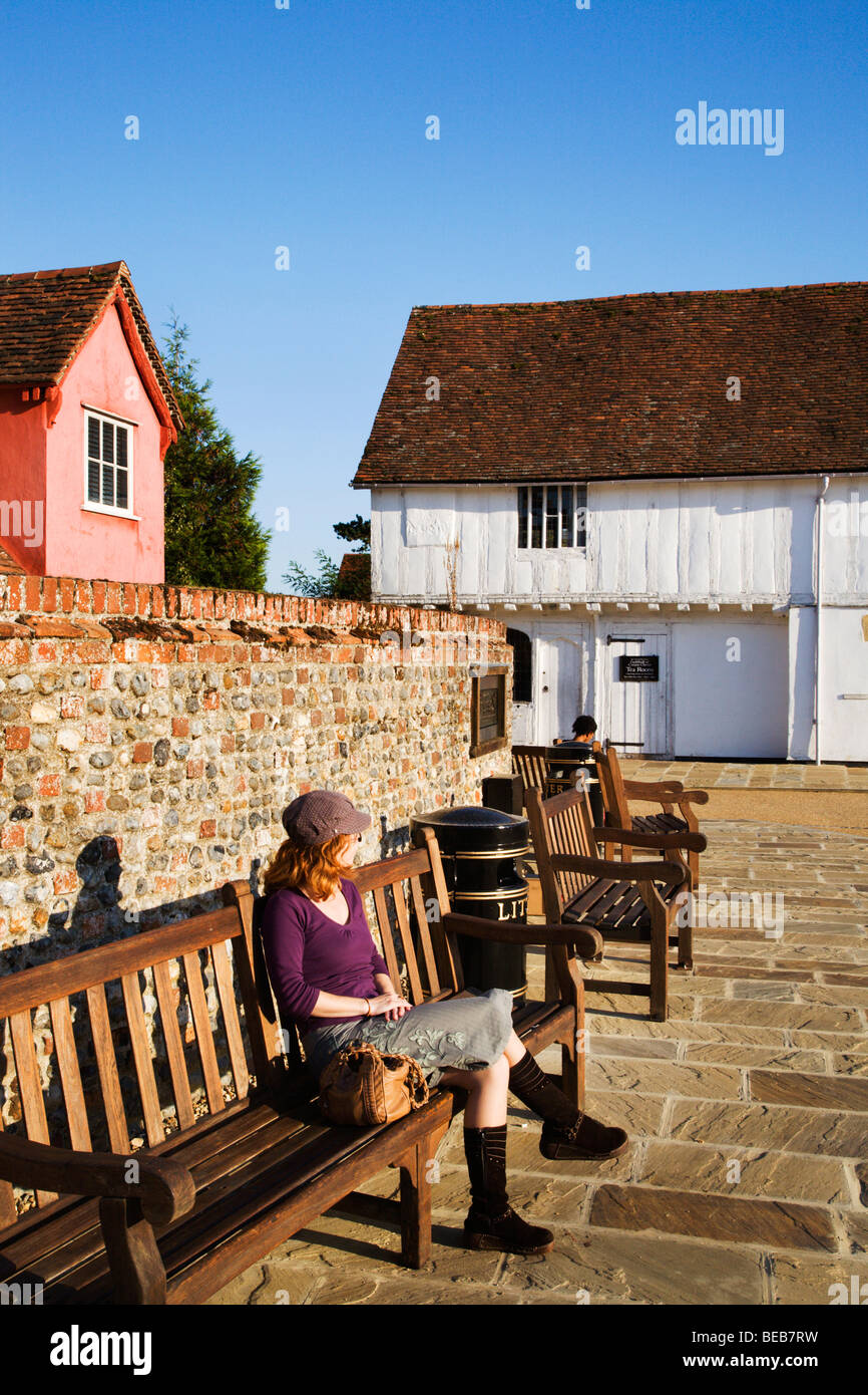 Woman Sitting in the Market Place Lavenham Suffolk England - Stock Image