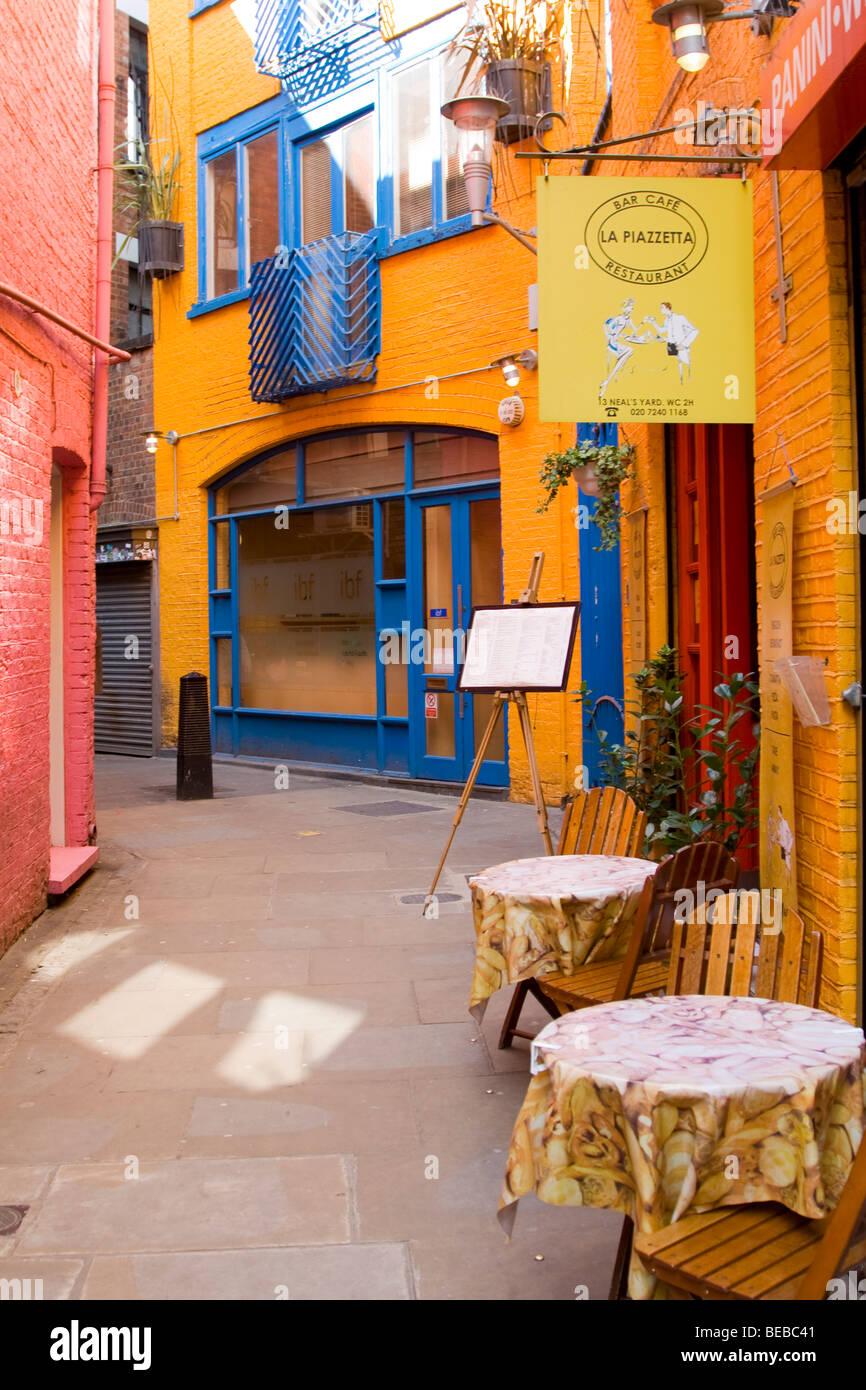 Cafe scene in Neil's Yard London - Stock Image