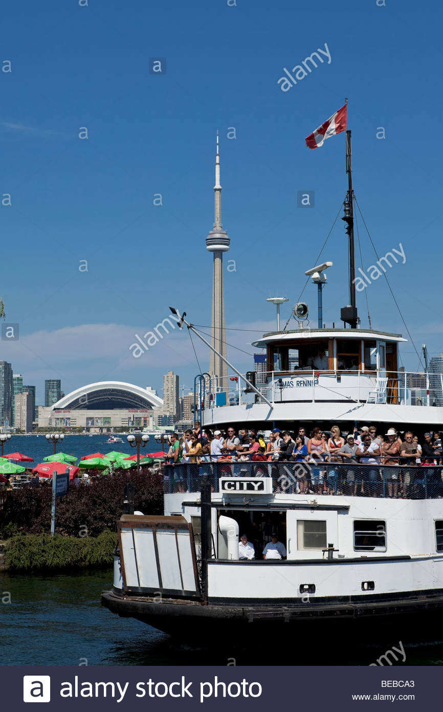 Ferry arriving at Toronto Islands Park with skyline in background at Toronto Ontario Canada Stock Photo